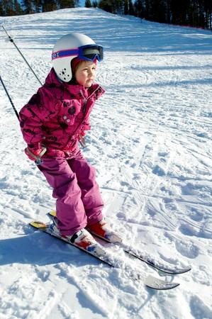 Beautiful girl on slalom skiing