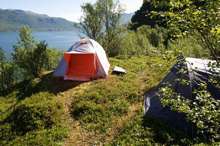 Tent in the Lofoten fjord view photo
