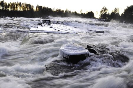Ice waterfall in the north of Sweden photo