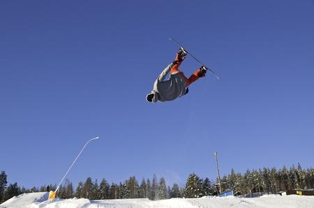 Snowboardist flying photo