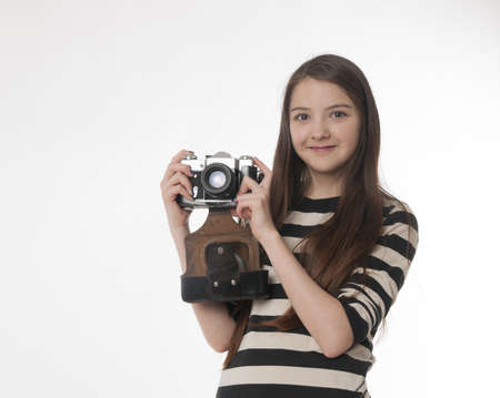 girl with old photokamera on white background photo