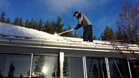 Cleaning snow from roof