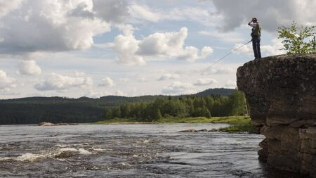 Fishing in Juoksengi, north of Sweden Stock Photo