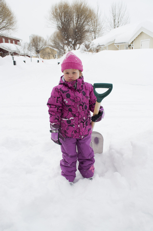 girl doing snow cleaning