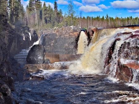 Jockfall, waterfall in the north of Sweden Фото со стока