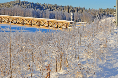 Wood brige on the winter river