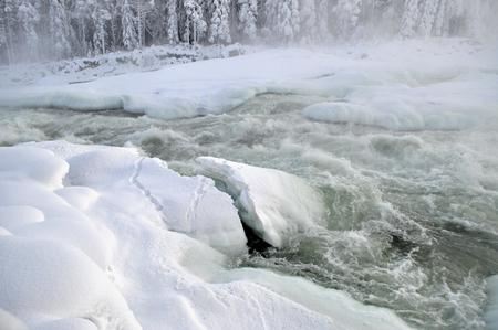 River in winter in North of Scandinavia Фото со стока