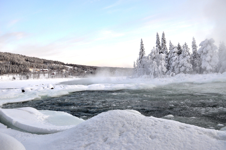 River in winter in scandinavia Фото со стока