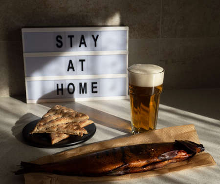 fight the virus, stay at home, keep safe, smoke fish with a beer Standard-Bild - 162939545