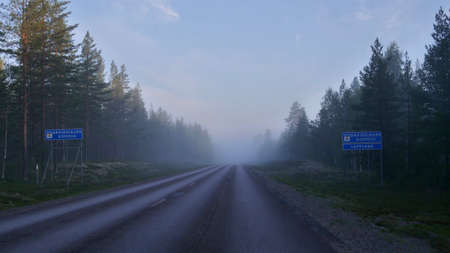 Road into the fog in the North of Swedish Lapland