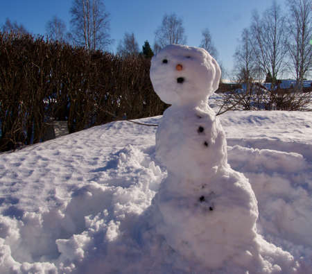 cute snowman in spring, at house