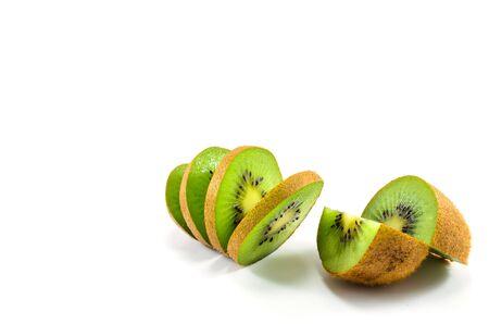 quartered: Views of quartered and sliced kiwi fruit Stock Photo