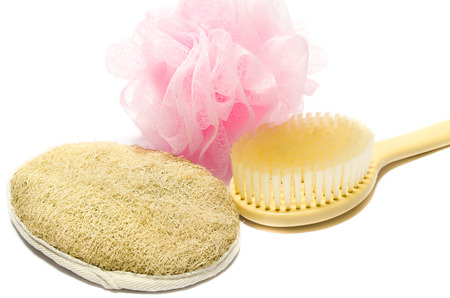 exfoliation: Skin exfoliation with soft, hard and long-handled scrubbers Stock Photo