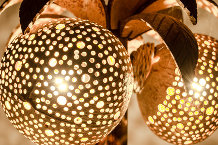 bedside lamp: Bedside lamp made from perforated coconut shell Stock Photo