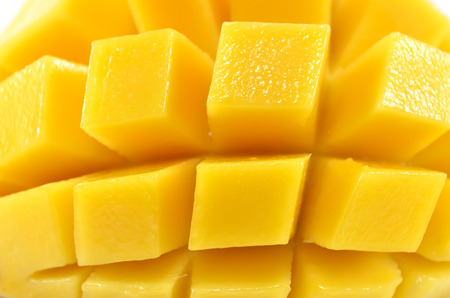Close up rip mango slice  cubes cut Stock Photo