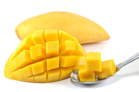 mango slice: Rip mango slice  cubes cut on white background Stock Photo