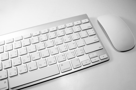 electronically: White keyboard with mouse on white background