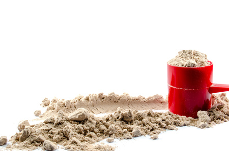 Whey protein powder with scoop on white background
