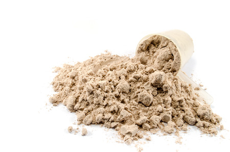 whey: Whey protein powder with scoop on white background