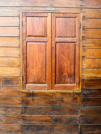 window shades: Wooden window shades in a wooden wall