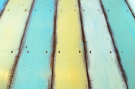painted background: Close up of some varied coloured planks