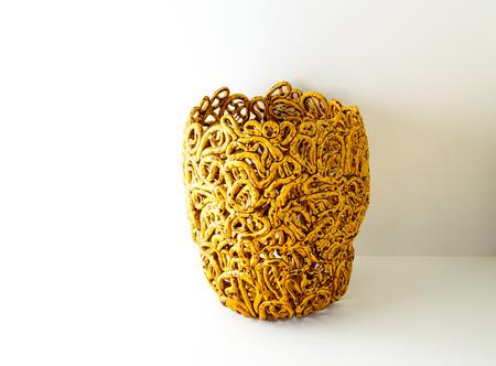 resemble: Ornamental ceramic vase moulded to resemble spaghetti