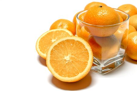 harvests: Whole oranges in glass and halved oranges Stock Photo