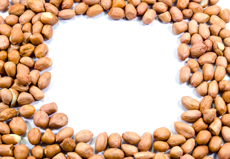 goober: Frame of raw peanuts on white background