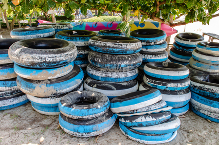 Floating tyres waiting for rent at the beach Thailand