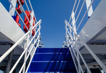Blue metal with railing on top deck ferry boat Standard-Bild