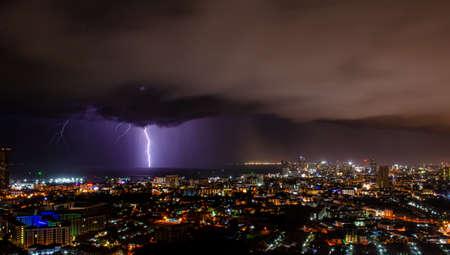 Looking over Pattaya to lightning at sea