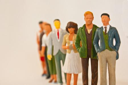 People figurines standing in line Reklamní fotografie