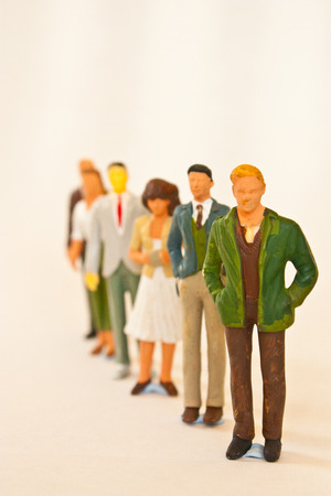 People figurines standing in line Standard-Bild