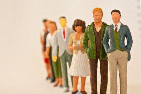 People figurines standing in line photo
