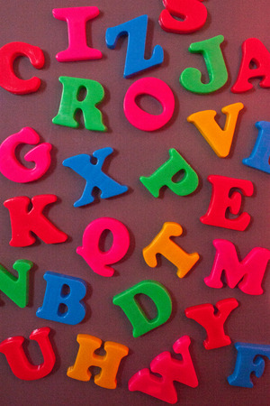 d i y: A variation of bright colored magnetic letters on a fridges side Stock Photo