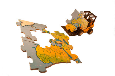 final piece of puzzle: A forklift truck carrying the last piece of the world map puzzle