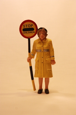 kind hearted: Figurine of an old lady holding a stop sign