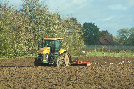 ploughing: A tractor ploughing the fields