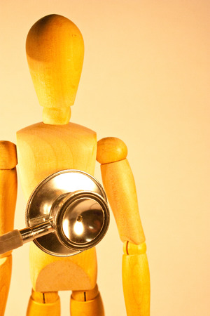 workplace wellness: Mannequin with stethoscope checking its body
