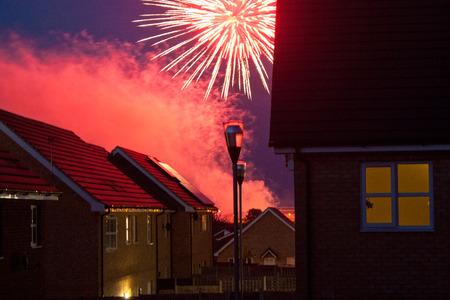 firework display: A firework display amongst British housing estates at night