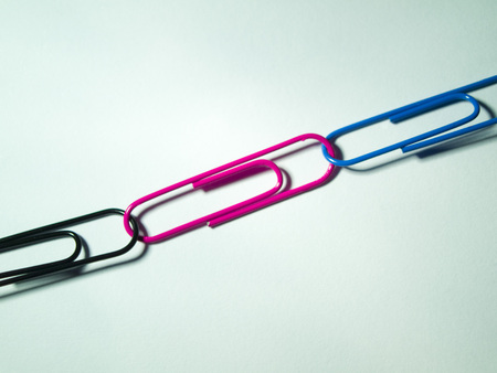 hooked: Interlinked paper clips that form a line Stock Photo