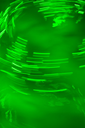 erratic: Erratic light green neon light swirling around Stock Photo