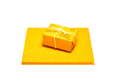 Small parcel on a small wooden slab Stock Photo