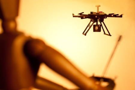 hobbyist: A mannequin using an unmanned system....otherwise known as a drone. Stock Photo