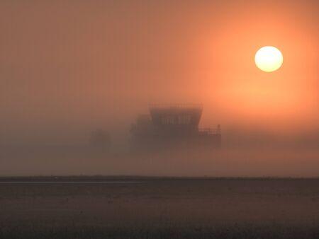 air: Air Traffic Control Foggy Sunrise Stock Photo