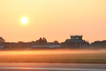 atc: Misty Airport Sunrise Stock Photo