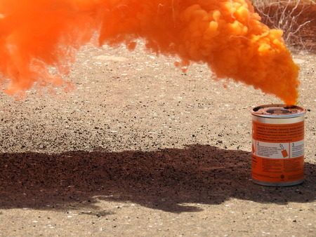A Bright Orange Smoke Grenade Used To Signal In The Event Of ...