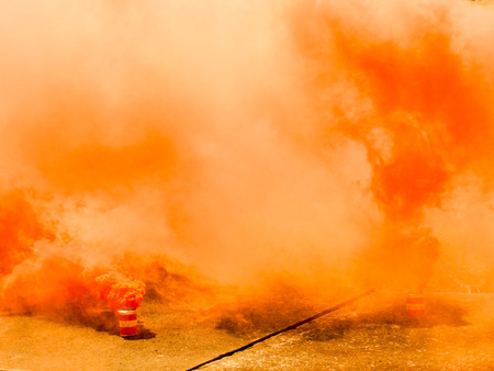 A bright orange smoke grenade used to signal in the event of rescue or to show a position from far away.