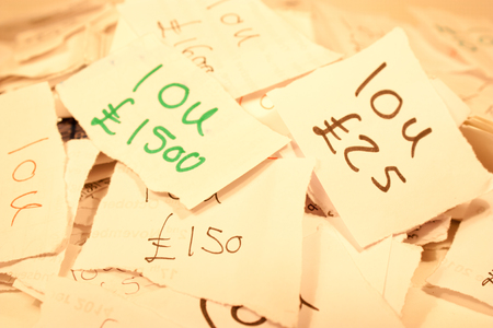 A closeup of a pile of I.O.Us that someone has written out. Banco de Imagens