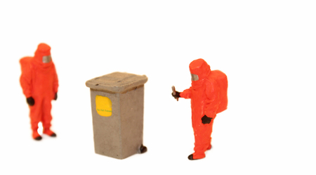 An inspection for chemicals or hazardous goods whilst wearing an orange chemical suit.